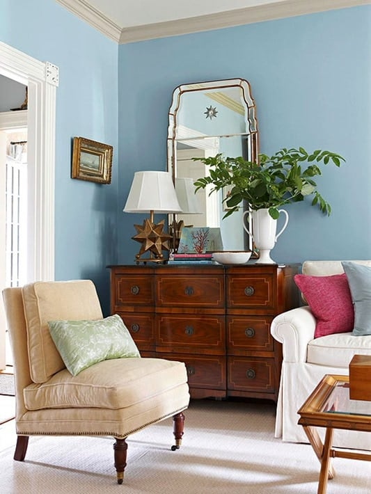 An Antique Chest Of Drawers In A Modern Living Room