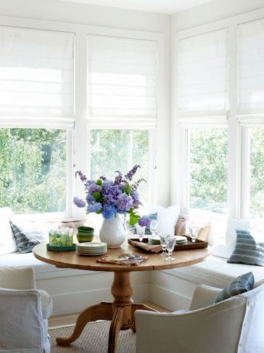 sustainable-furniture-a-bright-and-sunny-dining-nook-with-antique-table