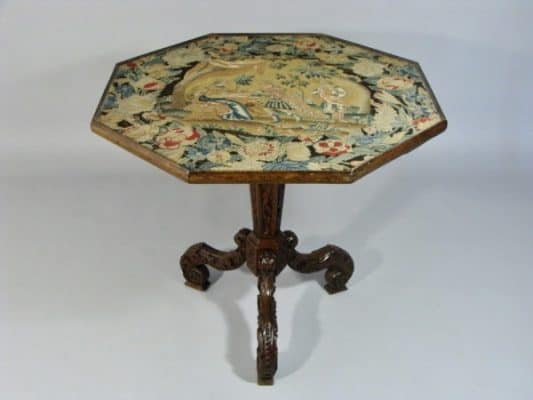 Needlework top of a game table