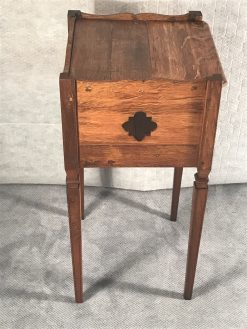 Two provincial nightstands- one of the two- side view with open work decor- styylish