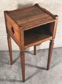 Two provincial nightstands- one of the two- three quarter view- styylish