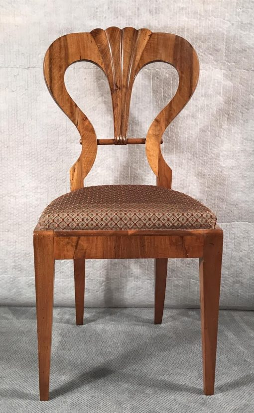 Six Biedermeier walnut chairs- one chair close up of the front- styylish