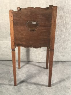 Two provincial nightstands- smaller table- side view of the smaller table- styylish