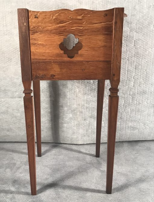 Two provincial nightstands- one of the two- side view with open work decor right- styylish