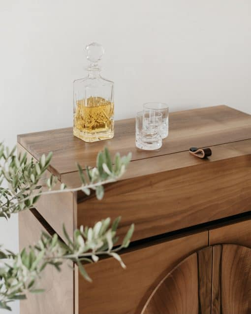 Custom made bar cabinet- detail of the closed top with glasses- styylish
