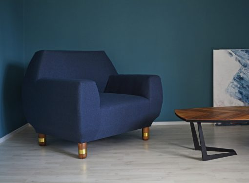 Upholstered Armchair- view of the blue covered armchair in a room- Styylish